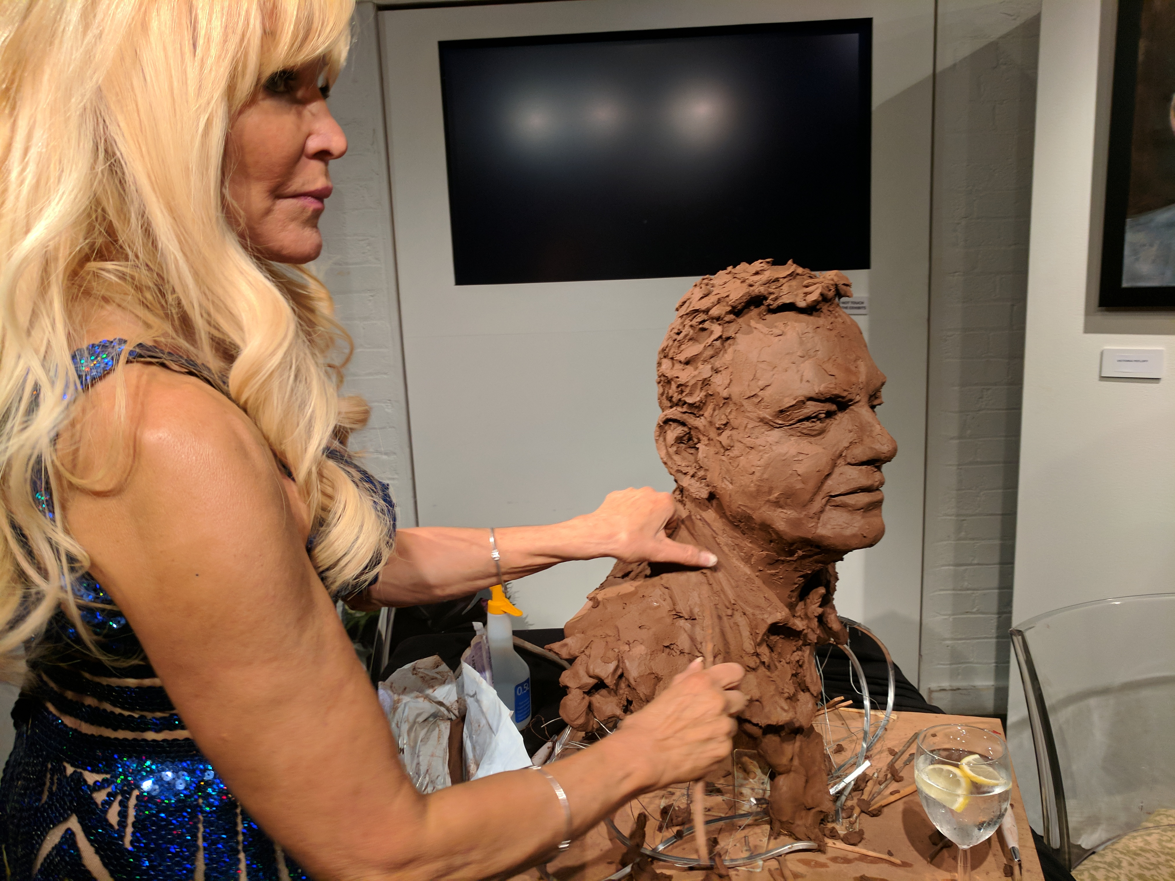 Royal Sculptress Frances Segelman sculpts Eamonn Holmes in aid of The Gesher School at The London Film Museum